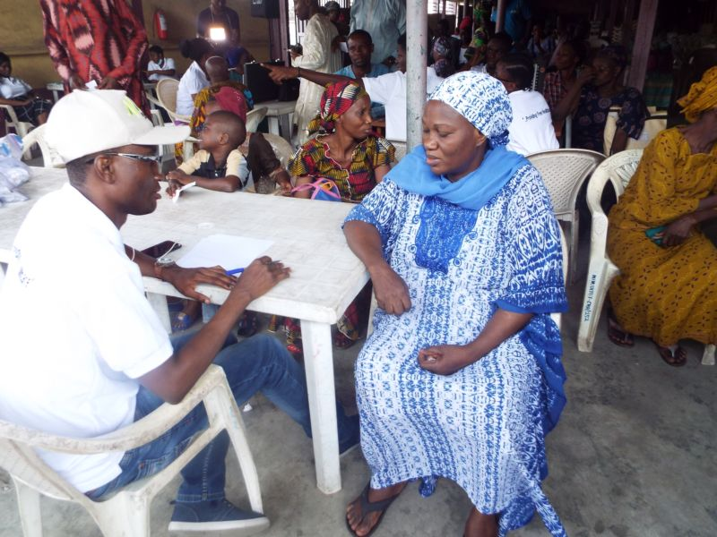 Dr David Ogunrinde (Family Health Physician) of Motus Health Initiative attending to a patient at Ire AkariIsolo Free Medical Outreach