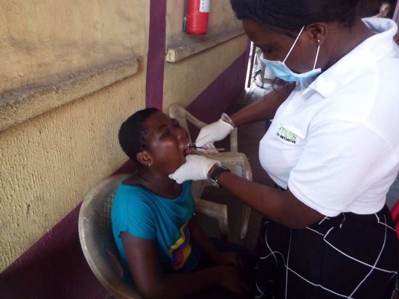 •	Dr Shola Agbogidi (Oral & Maxillofacial Surgeon) of Motus Health Initiative performing dental extraction at Ire Akari Isolo Free Medical Outreach