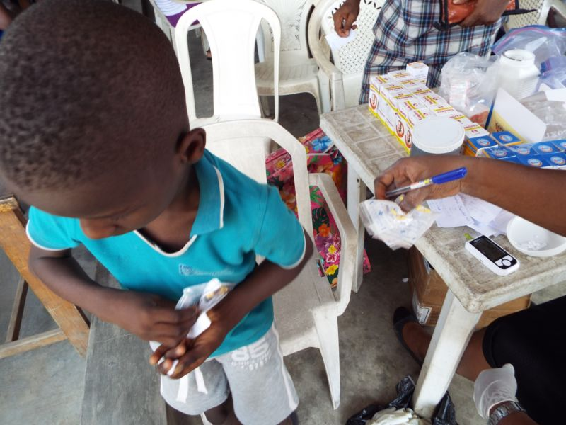A beneficiary of deworming program for children going with free deworming drugs at Ire Akari Isolo Free Medical Outreach